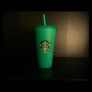 Green Starbucks changing cup
